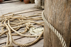 Rope and a wooden pole Royalty Free Stock Photos