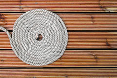 Rope on wooden yacht deck Royalty Free Stock Photos