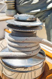 Rope wound around winch on sailboat Royalty Free Stock Image