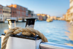 The rope is wound on a mooring. Boat on Canal Grande with Venezia. Venice, water, swim, boat, color, mooring Royalty Free Stock Photos