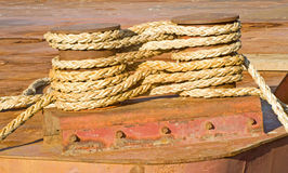 Rope wound securely around two cleats. An image of the securing rope of a boat wrapped around a double cleat Royalty Free Stock Image