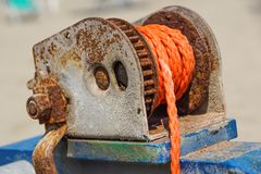 Rope wrapped around a well winder An old manila rope wrapped neatly and tightly around a pole. Rope wrapped around a well winder An old manila rope wrapped Royalty Free Stock Photography