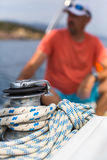 Rope on the yacht, a sailor is blurred in the background. Sport. Royalty Free Stock Photo
