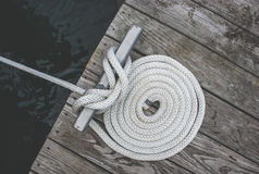 Rope coiled on a dock Stock Photo