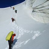 Roped team descending the icefall. Kuylu mountains, Central Tien-Shan, Kyrgyzstan Royalty Free Stock Images
