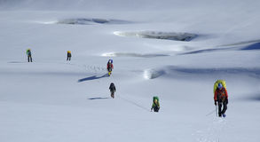 Roped team moving through a glacier. Tien Shan Royalty Free Stock Image