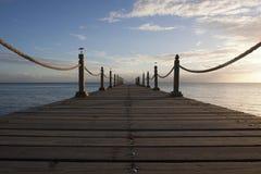 Roped Wooden Boardwalk over Ocean Stock Photos