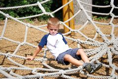 On the ropes. Young boy playing on ropes Royalty Free Stock Photo