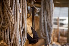 Ropes and an anchor on a small, old wooden jetty in the Mediterranean Sea stock photos