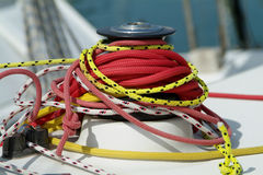 Ropes around a sailboat winch. Assorted ropes around the winch of a racing yacht Royalty Free Stock Images