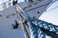 The ropes in the background the bow of the ship.  Royalty Free Stock Photos