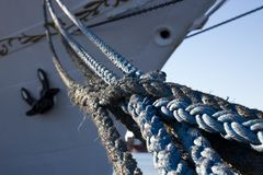 The ropes in the background the bow of the ship.  Royalty Free Stock Image