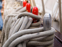 Ropes and belaying pin Stock Photography