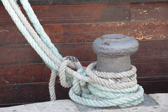Ropes and bollard Stock Images