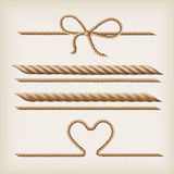 Ropes and bow. Ropes and rope bow on the light brown background Stock Image