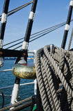 Ropes braided in bays on an ancient sailing vessel Stock Photo