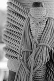 Ropes braided in bays on an ancient sailing vessel Royalty Free Stock Images