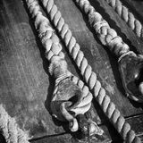 Ropes braided in bays on an ancient sailing vessel Stock Images