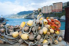 Ropes with buoys and the little harbour of Camogli city stock photography