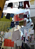 Ropes and clothes. Hanging clothes in Alfama,Lisbon, Portugal Stock Photo