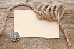 Ropes and compass Royalty Free Stock Photography