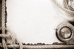 Ropes and compass on old grunge old paper Stock Photography