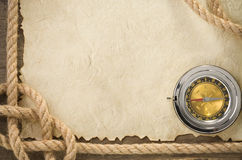 Ropes and compass at old vintage ancient paper Stock Image