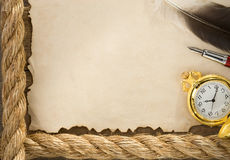 Ropes and compass on old vintage paper background Stock Images