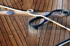 Ropes and deck. Detail of ropes on wooden desk of an sail boat royalty free stock image