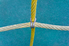 Ropes fastened by a clamp Royalty Free Stock Image