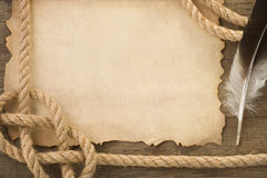 Ropes and feather on old vintage ancient paper Royalty Free Stock Images