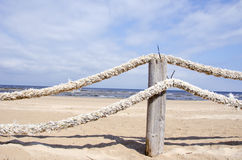 Ropes fence on resort beach nea sea Stock Image