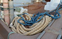 Ropes, floats on the floor of a fishing boat. Fishing boats at the dock. Boat moored in the harbor. Ropes, floats on the floor of a fishing boat royalty free stock image