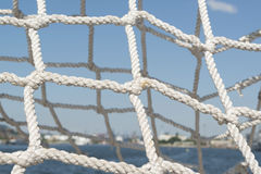 Ropes knots net. On blue sky Royalty Free Stock Photo