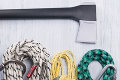 Ropes for lifting on high rocky mountains and an ax, background close up stock photos