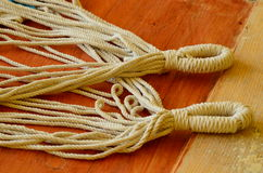 Ropes with loops on wooden background Royalty Free Stock Photos