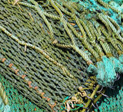 Ropes and Nets. Nets on a boat in a harbor stock photos