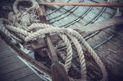 Ropes and oars in a boat. Ropes and oars in a wooden boat Royalty Free Stock Photo