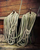 Ropes on an old sailboat. Ropes fastened around cleats on an old sailboat stock photo
