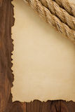 Ropes on old vintage ancient paper background Royalty Free Stock Photo