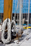 Ropes and pulleys on deck of ship. With blue sea in the background royalty free stock photography