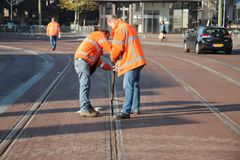 Ropes in the rails of street cars in The hague to protect that wheels of coaches during the Prinsjesdag parade get stuck royalty free stock image