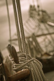 Ropes and rigging on old ship. Black and white view of ropes and rigging on old schooner ship at sea Royalty Free Stock Image