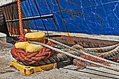 Ropes and rust detail of ship in harbour Stock Images
