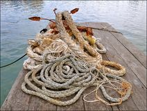Ropes and rusty anchor stock image