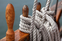 Ropes on sailing ship. White ropes on the wooden deck of the sailing ship, shallow focus stock image