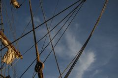 Ropes and sails of an old wooden boat royalty free stock photography