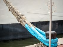 Ropes from ship using marine bollards rope to anchor to dock royalty free stock photo