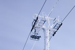 Closeup ropes of ski lift, cable car funicular with pillar on th stock image