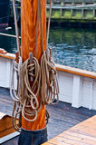 Ropes on  tallship mast. Ropes on tall-ship  cleat Royalty Free Stock Images